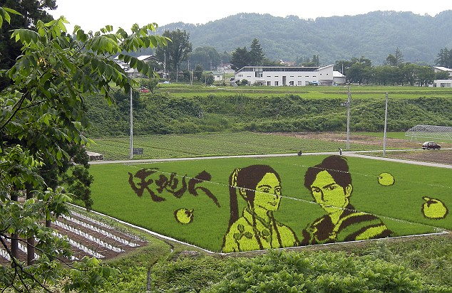 Fictional warrior Naoe Kanetsugu and his wife Osen appear in fields in the town of Yonezawa, Japan